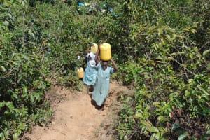 The Water Project: Lwanga Itulubini Primary School -  Carrying Water