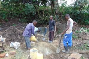 The Water Project: Kambiri Community, Sachita Spring -  Mixing Cement