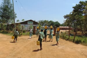 The Water Project: Lwanga Itulubini Primary School -  Arriving Back At School With Water