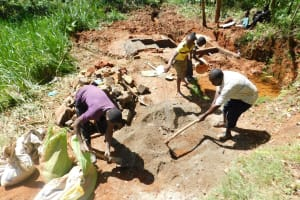 The Water Project: Mukhunya Community, Mwore Spring -  Mixing More Cement