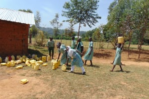 The Water Project: Lwanga Itulubini Primary School -  Dropping Water Off At Kitchen