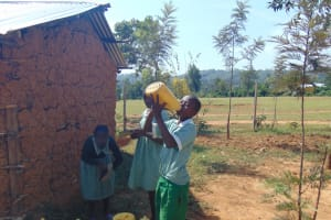 The Water Project: Lwanga Itulubini Primary School -  Student Drinking Water