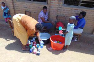 The Water Project: Lwanga Itulubini Primary School -  Serving Porridge