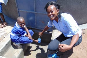 The Water Project: Musango Primary School -  Water Flowing