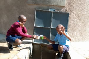 The Water Project:  Amos And Brian At The Tank