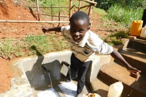 The Water Project: Mukhunya Community, Mwore Spring -  Flowing Water