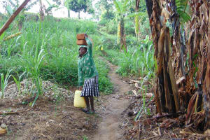 The Water Project: Bukhakunga Community, Mukomari Spring -  Carrying Bricks To The Artisan