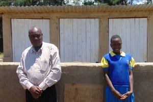 The Water Project: Chebunaywa Primary School -  Mr John Mundehe With Marion Cheagat