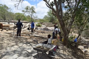 The Water Project: Mbau Community B -  Community Members Help In Construction