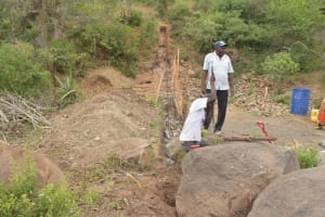 The Water Project: Mbau Community B -  Digging Out Dam Area