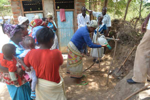 The Water Project: Mbau Community B -  Testing Out Tippy Tap