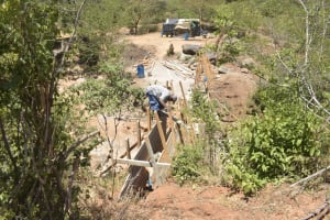 The Water Project: Mbau Community B -  Working On Dam