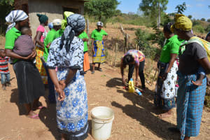 The Water Project: Ndithi Community -  Demonstration On How To Construct A Handwashing Station