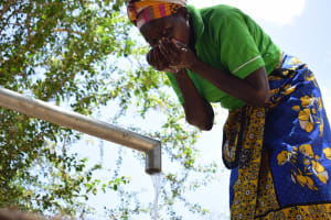 The Water Project: Ndithi Community A -  Drinking The Well Water
