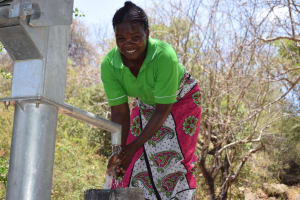 The Water Project: Ndithi Community A -  Smiles For Reliable Water