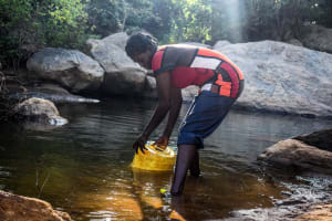 The Water Project: Kasekini Community -  Fetching Water