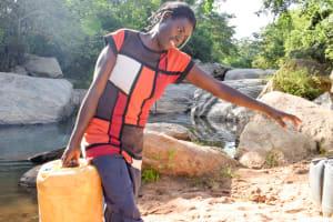 The Water Project: Kasekini Community -  Hauling Water