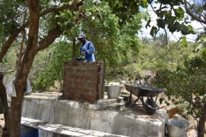The Water Project: Mbau Community C -  Building Well Walls