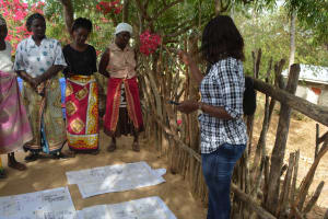 The Water Project: Mbau Community C -  Listening To Training Facilitator
