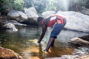 The Water Project: Kasekini Community A -  Fetching Water