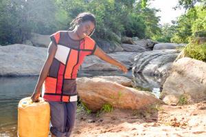 The Water Project: Kasekini Community A -  Hauling Water