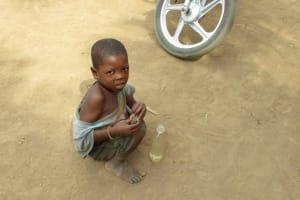 The Water Project: Kamayea, Susu Community & Church -  Child Playing On Ground