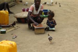 The Water Project: Kamayea, Susu Community & Church -  Woman Graining Groundnut