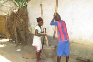 The Water Project: Lokomasama, Musiya, Nelson Mandela Secondary School -  Children Pounding Rice