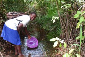 The Water Project: Lokomasama, Musiya, Nelson Mandela Secondary School -  Student Fetching Water