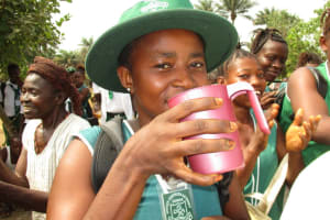 The Water Project: UBA Senior Secondary School -  Drinking Clean Water From The Well
