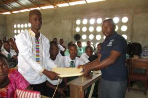 The Water Project: UBA Senior Secondary School -  Handing Over The Hygiene File To Senior Teacher