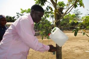 The Water Project: UBA Senior Secondary School -  Headman Using Tippy Tap