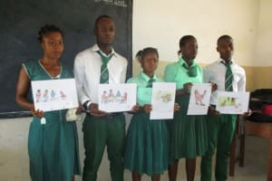 The Water Project: UBA Senior Secondary School -  Students Participate In Training By Holding Learning Materials