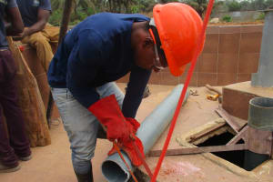 The Water Project: Rowana Junior Secondary School -  Cutting Pipe