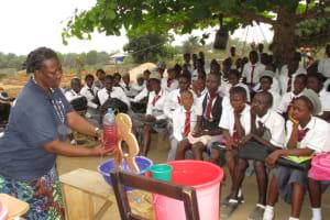 The Water Project: Rowana Junior Secondary School -  Hygiene Facilitator Teaching About Diarrhea Through Diarrhea Doll