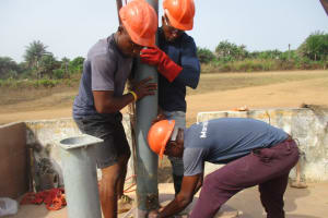 The Water Project: Rowana Junior Secondary School -  Inserting Casing