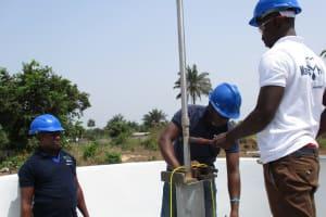 The Water Project: Rowana Junior Secondary School -  Installing Pump