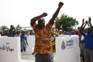 The Water Project: Rowana Junior Secondary School -  Mr David S Conteh School Principal Celebrating Safe Drinking Water