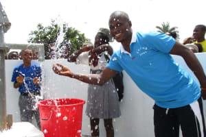 The Water Project: Rowana Junior Secondary School -  School Staff And Students Celebrating Fro Safe Drinking Water