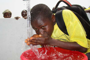 The Water Project: Rowana Junior Secondary School -  Student Drinking Water
