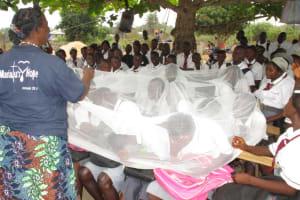 The Water Project: Rowana Junior Secondary School -  Students Learn About Using Mosquito Net