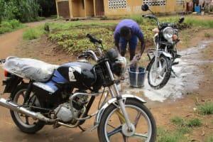 The Water Project: Lungi, Rotifunk, 1 Aminata Lane -  Washing Motorcycle