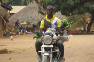 The Water Project: Lokomasama, Gbonkogbonko, Kankalay Primary School -  Community Activity Motor Bike Transportation