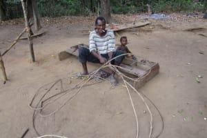 The Water Project: Lokomasama, Gbonkogbonko, Kankalay Primary School -  Community Activity Old Man Preparing Fishing Net