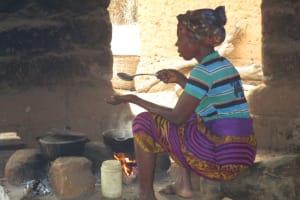 The Water Project: Lokomasama, Gbonkogbonko, Kankalay Primary School -  Community Activity Old Woman Cooking