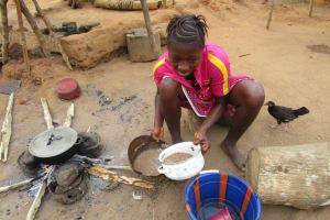 The Water Project: Lokomasama, Gbonkogbonko, Kankalay Primary School -  Community Activity Young Lady Cooking