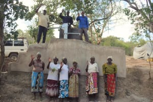 The Water Project: Mbau Community C -  Community Members Celebrating The Finished Well