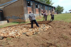 The Water Project: Ibwali Primary School -  Buidling The Foundation Temporary Construction Water Tank In Background