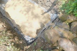 The Water Project: Munenga Community, Burudi Spring -  Laying The Foundation