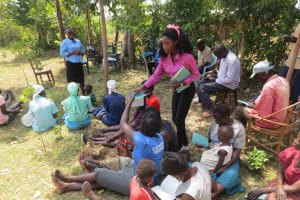 The Water Project: Mukhuyu Community, Kwawanzala Spring -  Handing Out Notebooks
